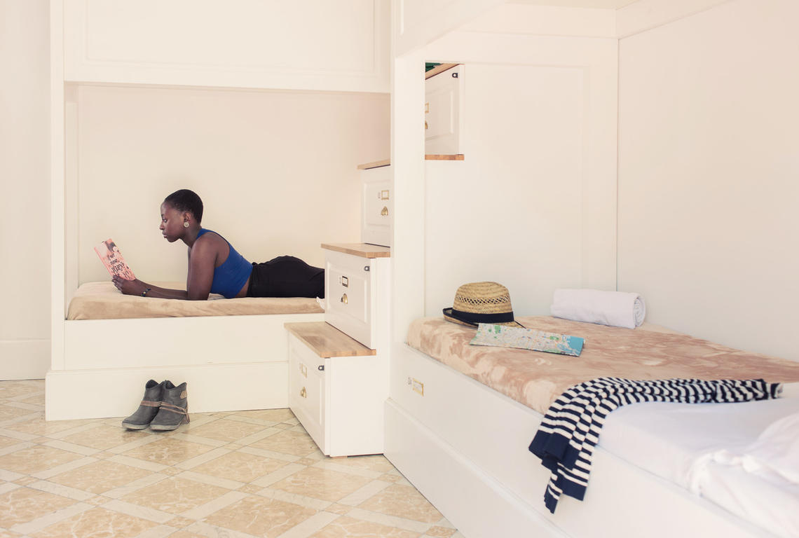 Woman lying on bed at Barcelona hostel, Casa Gracia, by Hostelworld