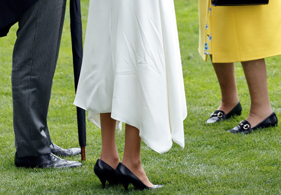 Meghan wears big shoes