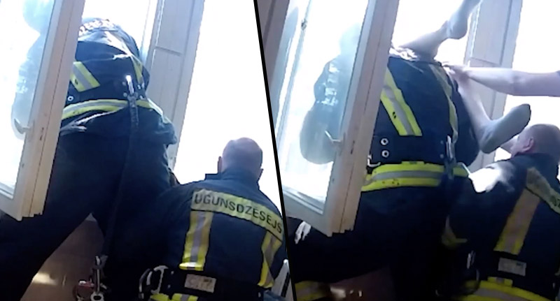 Fireman Leans Out Window catches Suicidal Man