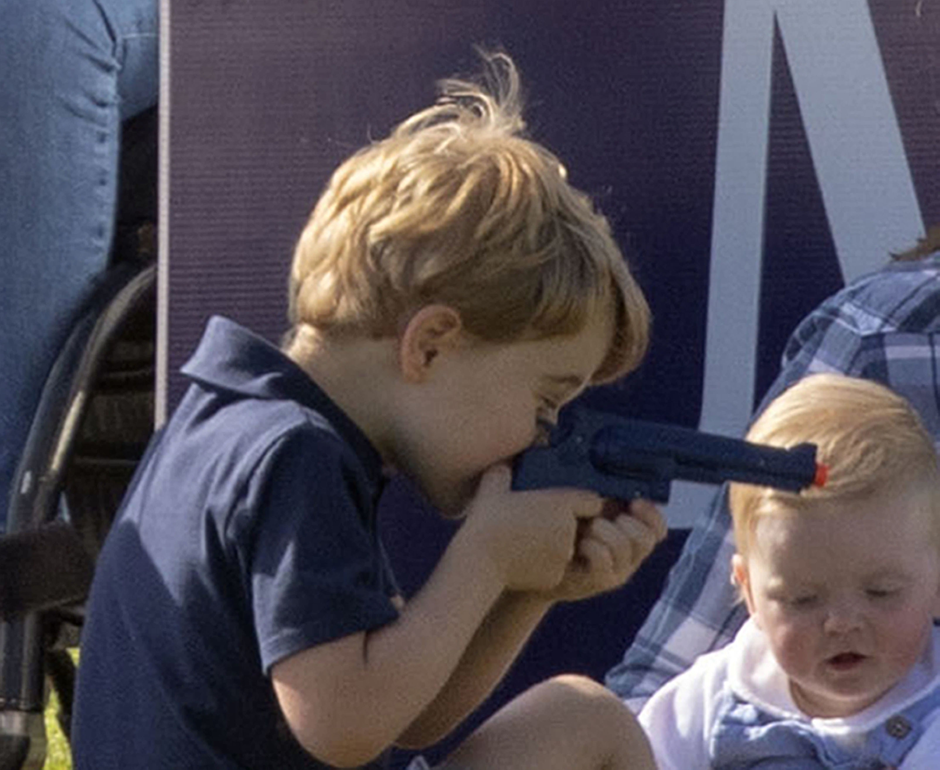 Prince George playing with toy gun