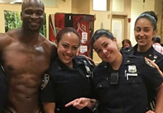 Police pose with stripper