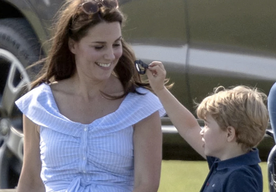 Prince George playing with Kate Middleton