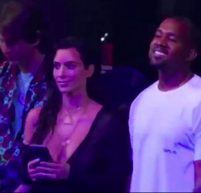 Kanye West watches Rihanna with Kim Kardashian
