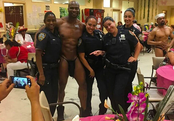 Police officers pose with stripper