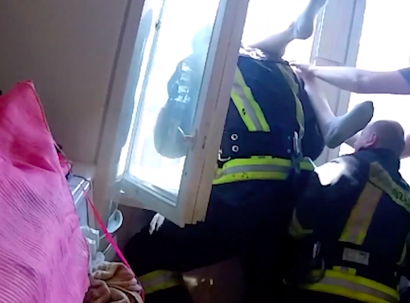 Fireman Leans Out Of Window And Catches Suicidal Man