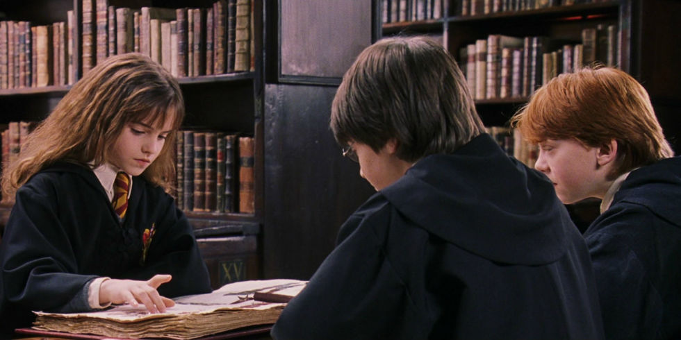 Harry Potter, hermione and Ron reading in Harry Potter and the Philosopher's Stone