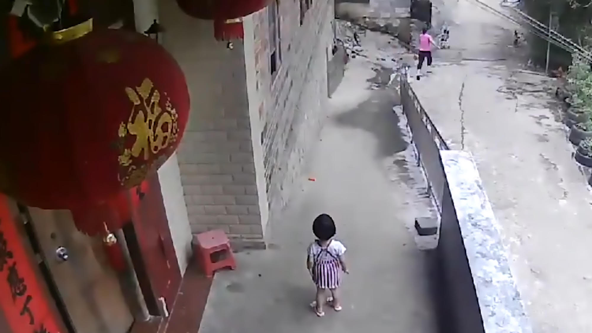 girl pushes brother down hill
