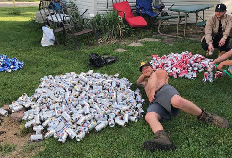 Guy sitting in front of empty beer cans