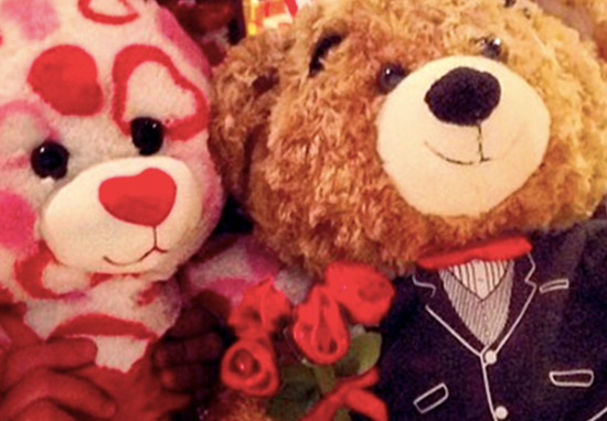 Build-A-Bear workshop bears holding roses