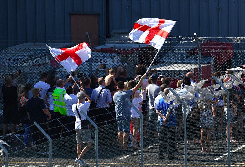 People waving England flags