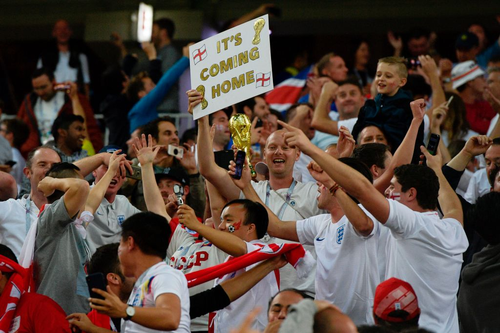 England's fans celebrate their team's win after the penalty shootout at the end of the Russia 2018 World Cup