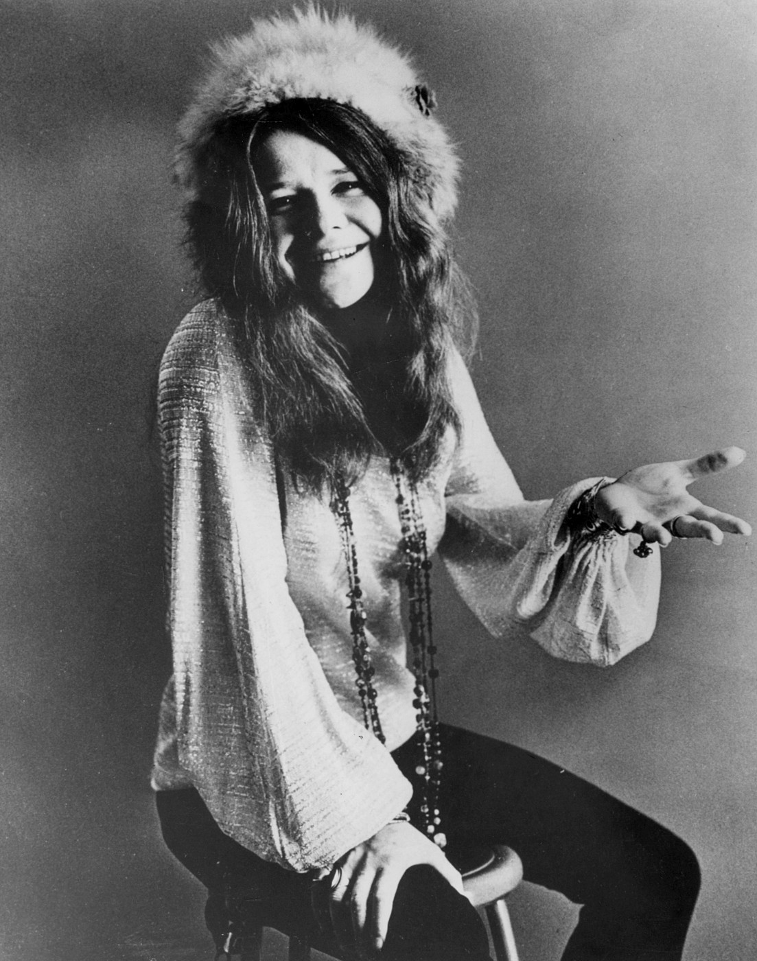Singer and 27 Club member, Janis Joplin, seated and smiling