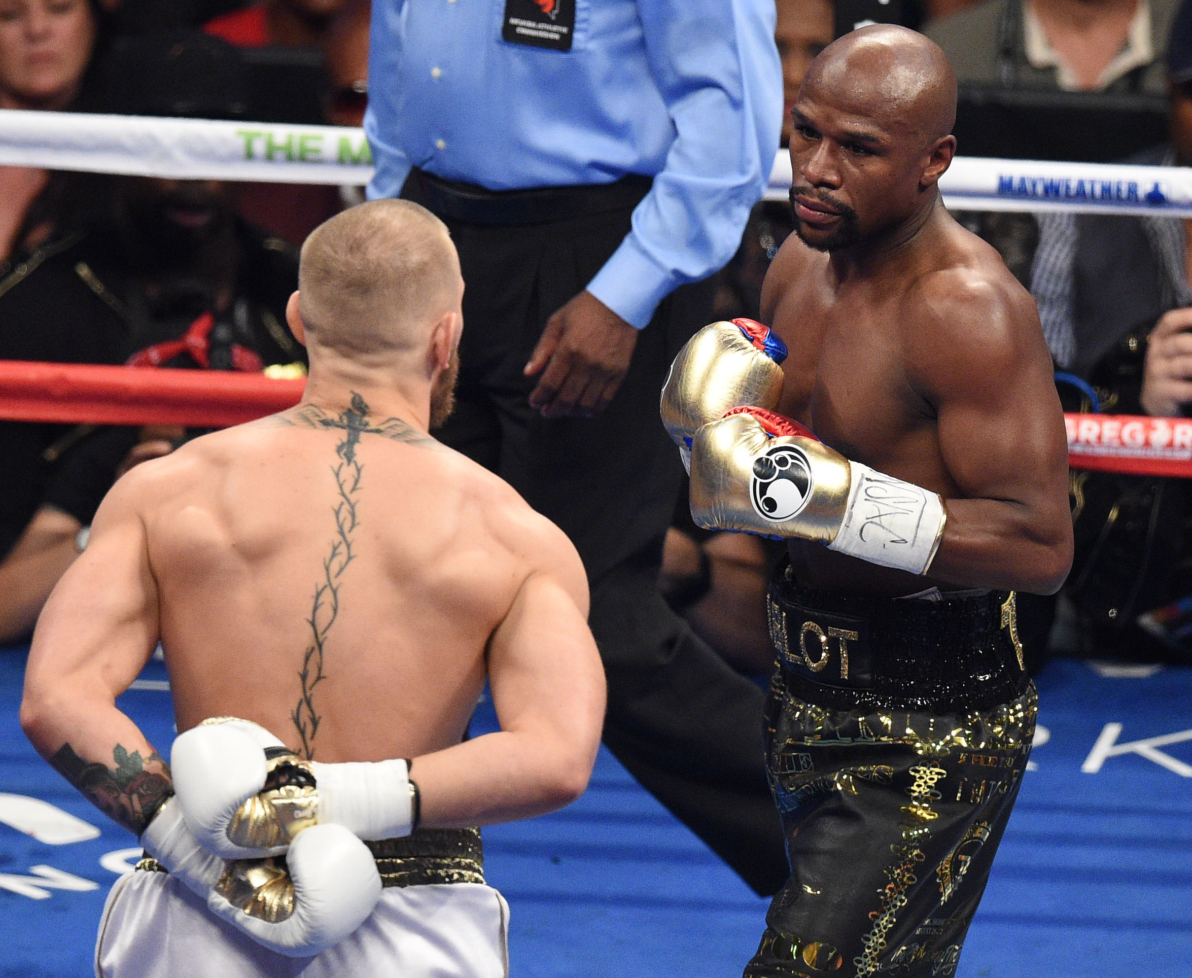 Conor McGregor taunts Floyd Mayweather, fighting with his hands behind his back.