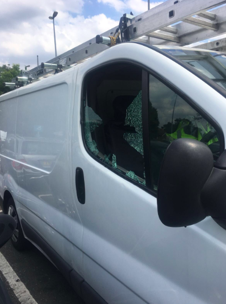 Police smash van to rescue dog