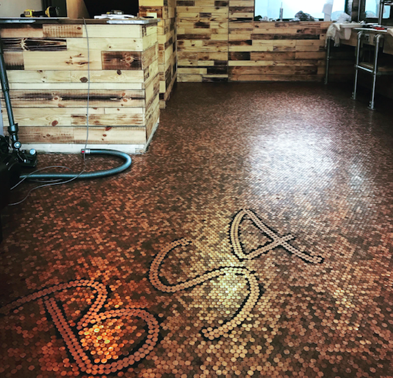 Barber creates shop floor from pennies