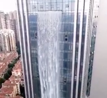 China Builds Incredible 350ft Artificial Waterfall On A Skyscraper Screen Shot 2018 07 23 at 18.08.27