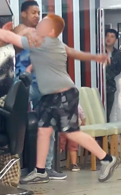 kid tries knock out barber haircut