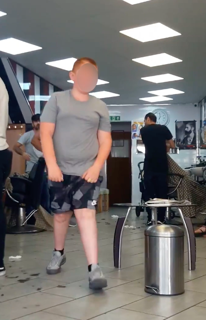 Kid Tries To Knock Out Barber For Giving Him A Bad Haircut Screen Shot 2018 07 27 at 14.30.36