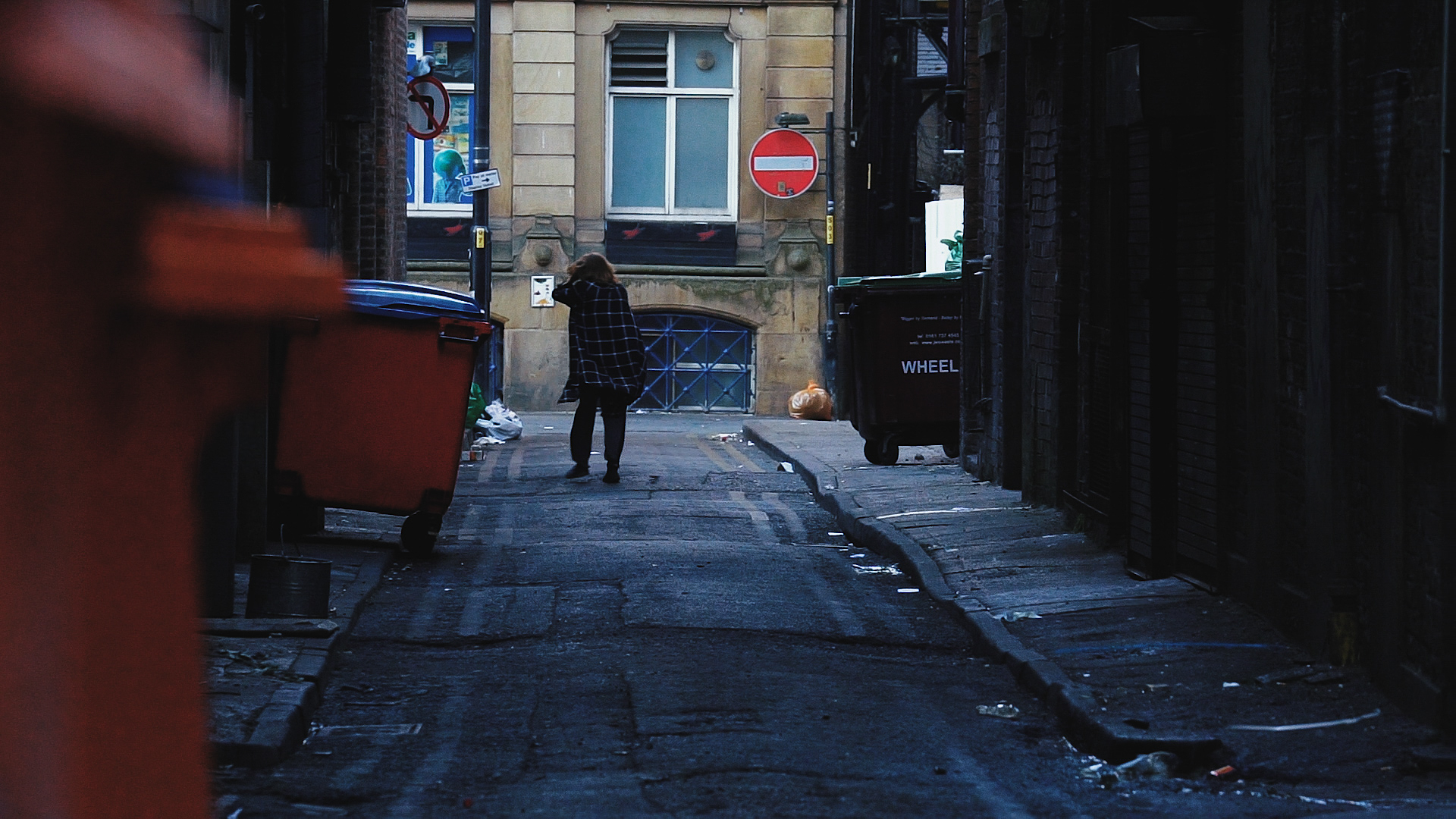 Homeless man on spice wandering a Manchester alley