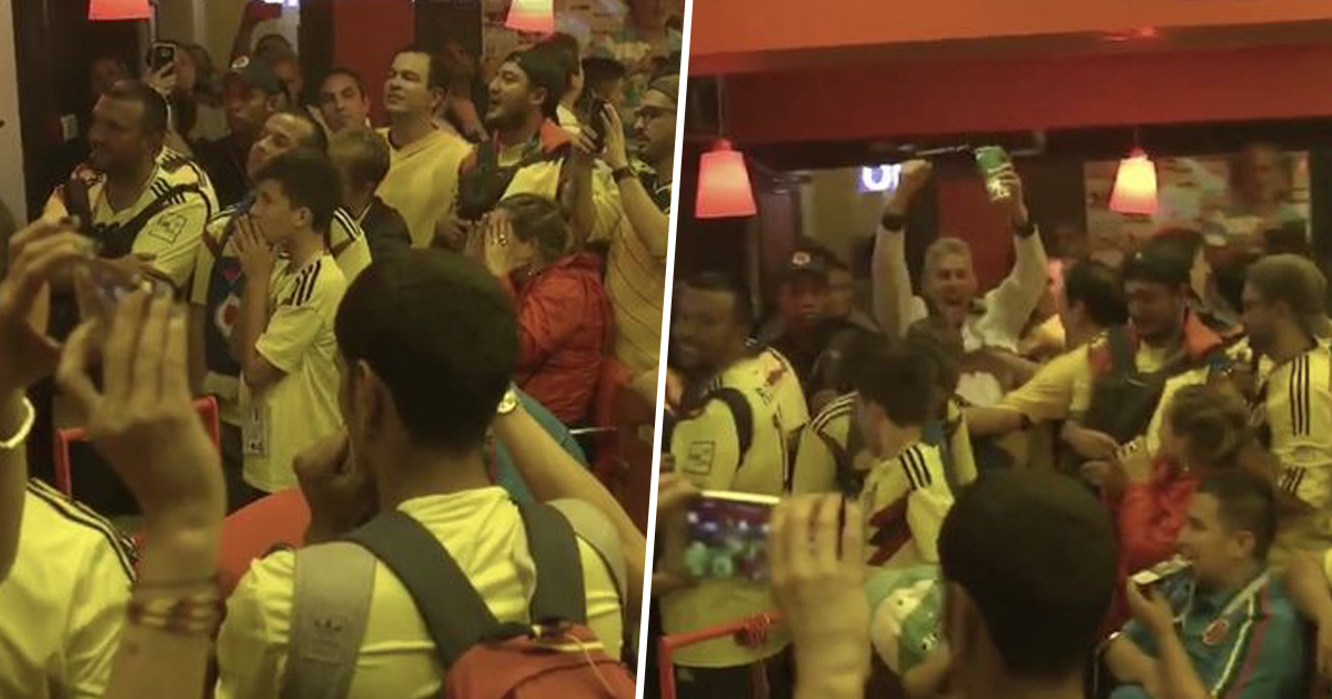 England fan celebrates among Colombians