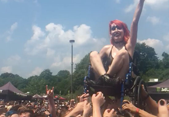 Woman In Wheelchair Loves Crowdsurfing At Metal Gig crowdsurf1