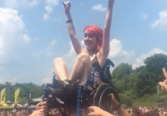 Woman In Wheelchair Loves Crowdsurfing At Metal Gig crowdsurf2