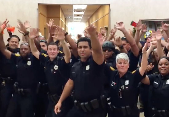 Police lip sync to uptown funk