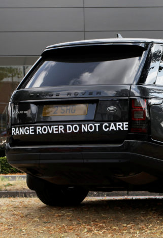 Angry driver parks Land Rover at dealership.