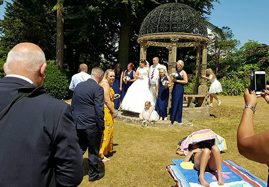 Sunbather Ruins Wedding Photos By Refusing To Move sunbather1