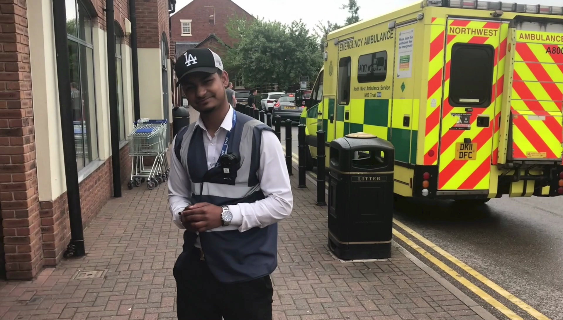 Parking attendant gives fine to ambulance.