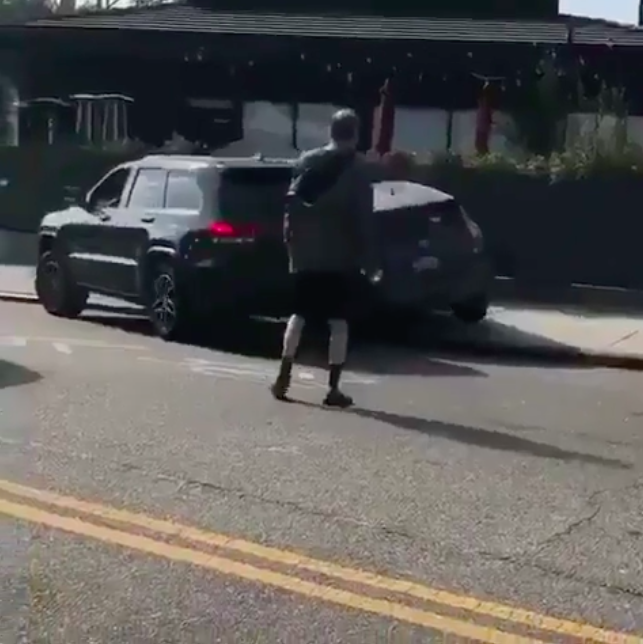 Guy who has road rage runs over other car.