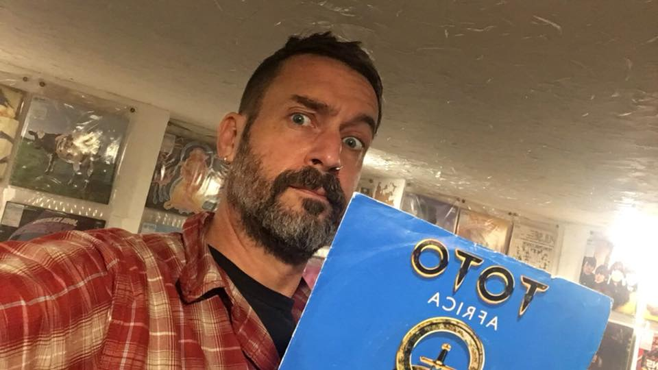 DJ holding Toto Africa record