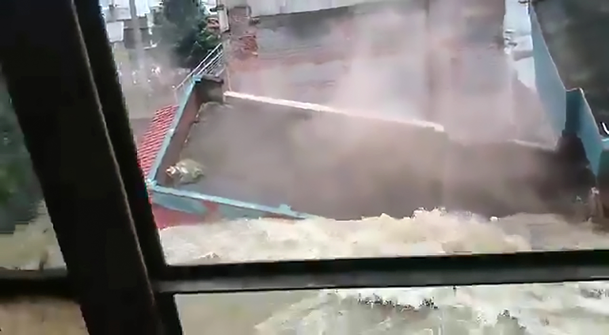 Houses Crash Into Canal During Floods