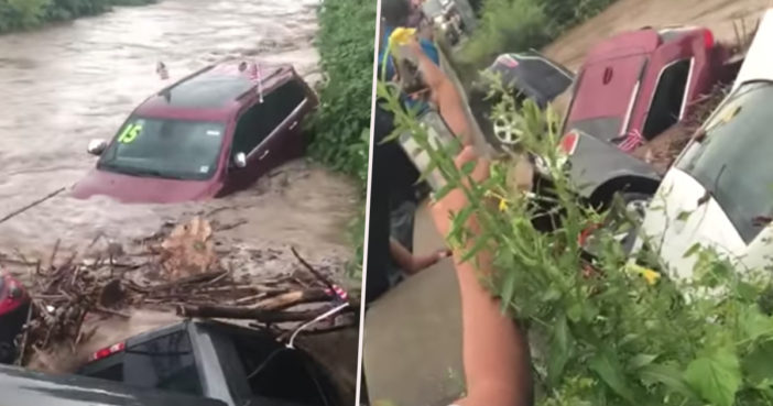Cars swept away by floodwater.