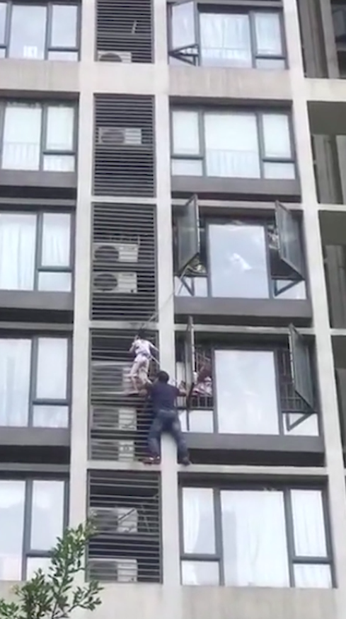 Dad climbs building to save son