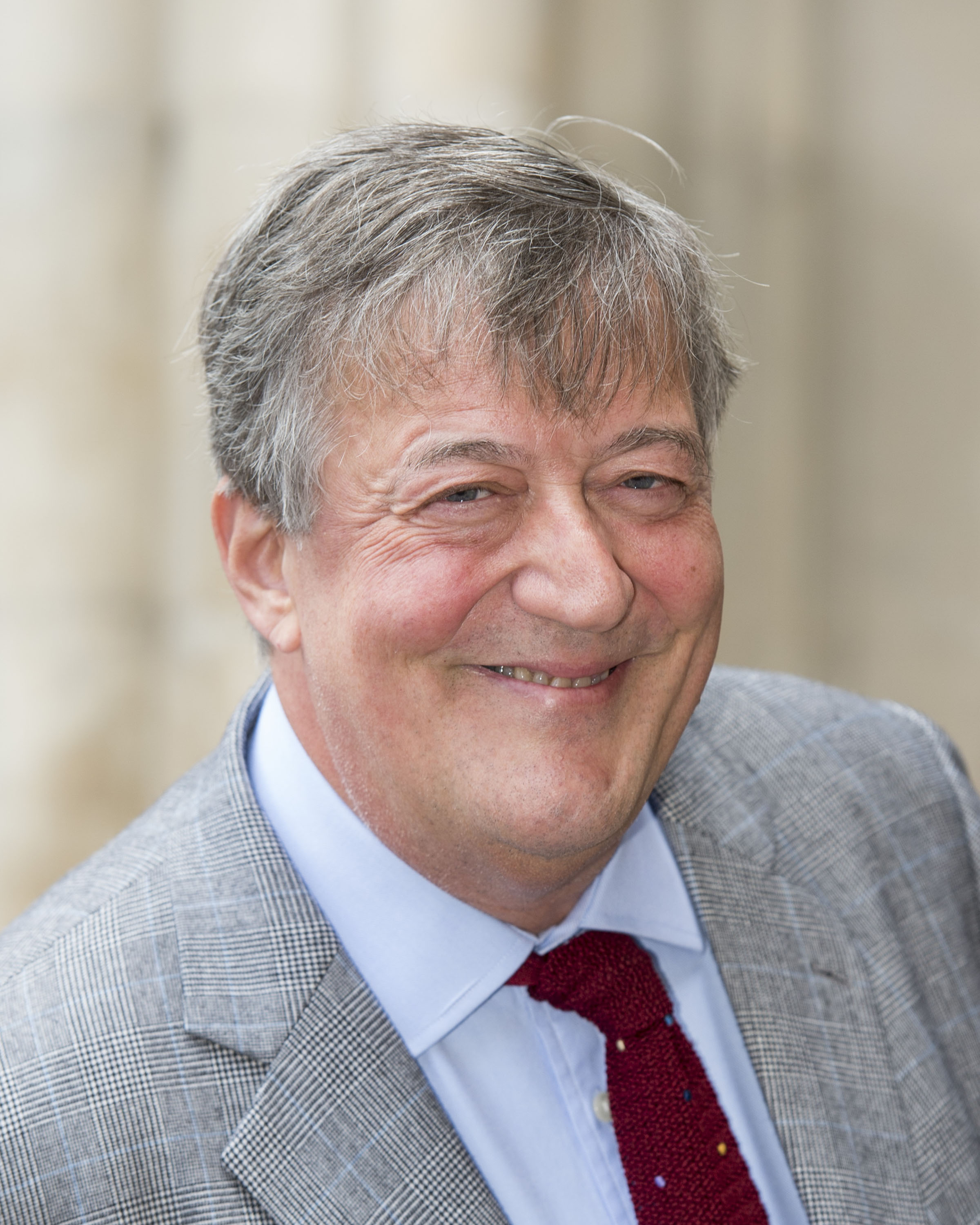 Stephen Fry attends a memorial service for comedian Ronnie Corbett at Westminster Abbey
