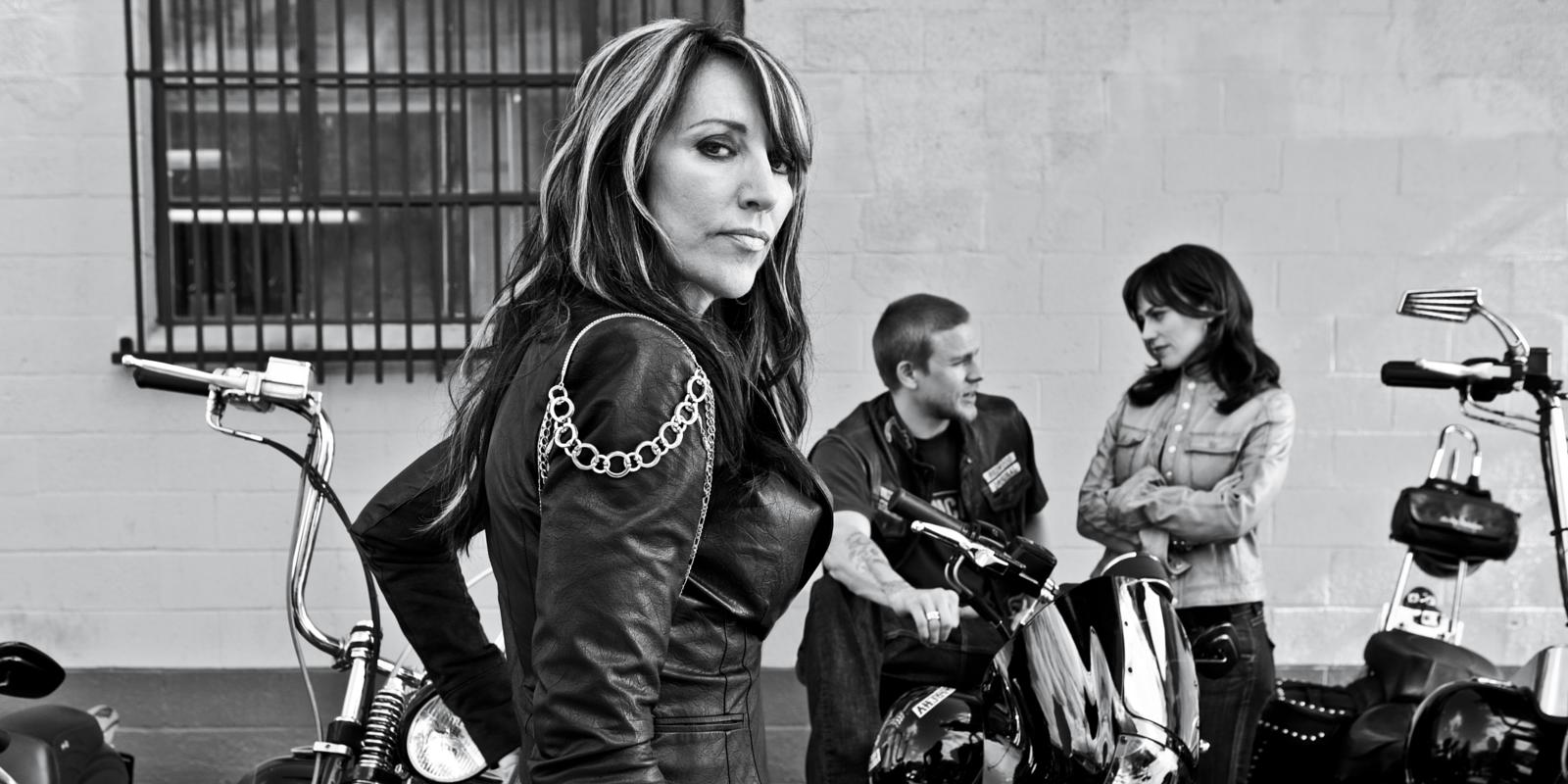 Katey Sagal poses besides bikes on Sons of Anarchy