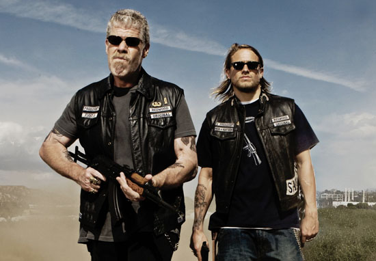 Jax Teller and his step-dad Clay carrying weapons in Sons Of Anarchy