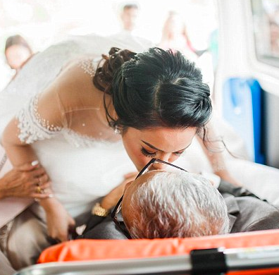 Dying father walks daughter down the aisle.