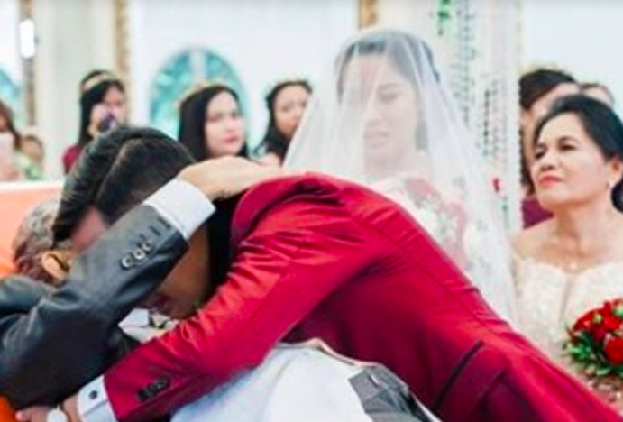 A bride's dying father escorted her down the aisle on a stretcher.