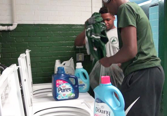 Pupils washing clothes