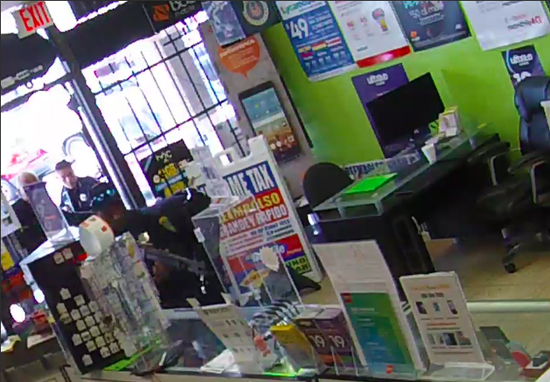 armed robber locked phone shop