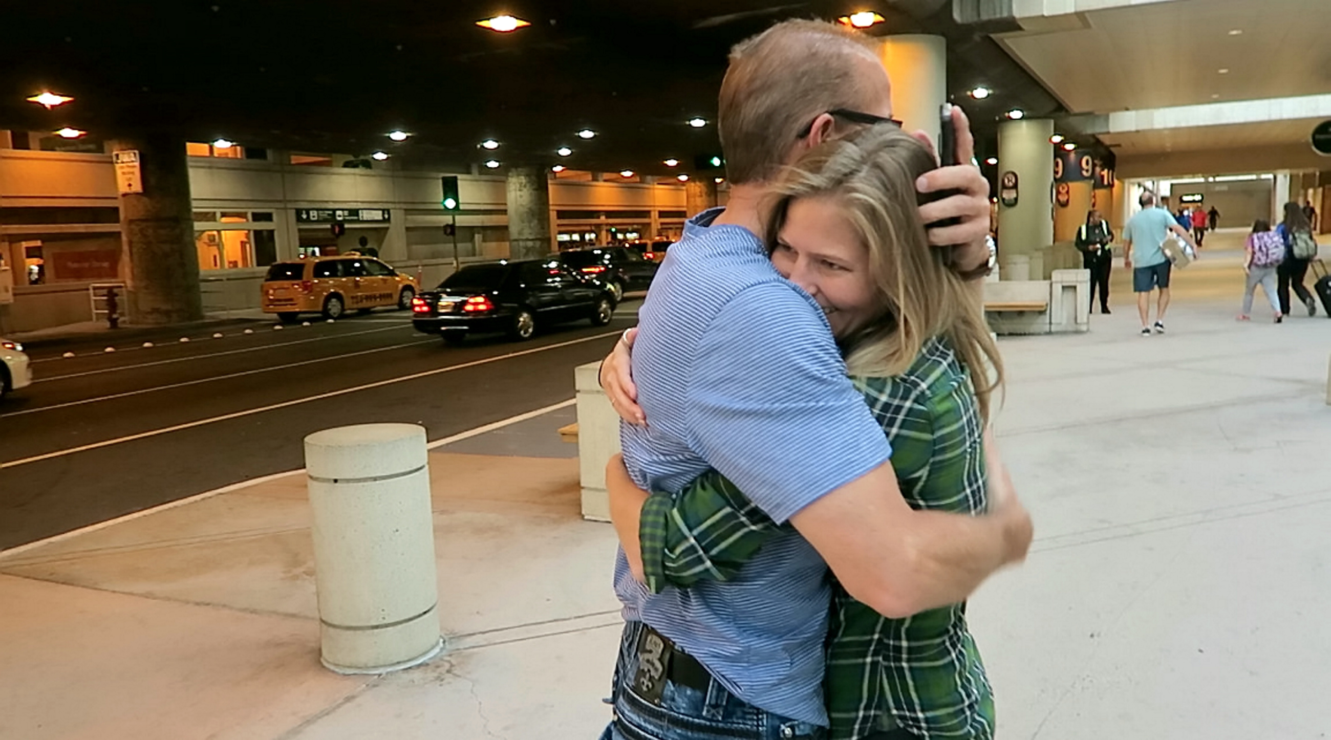 Michelle hugs biological dad for first time at Orange County airport