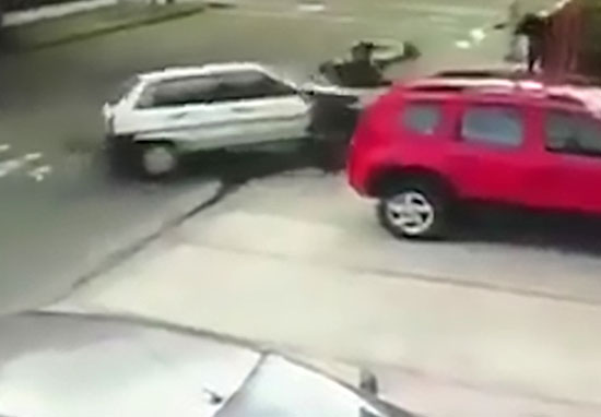Car smashes into armed robbers