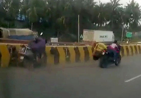 Girl clings to motorbike after parents are flung off