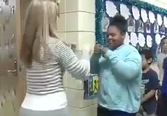 Teacher has handshake for each student