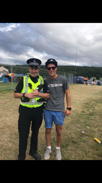 Guy at festival with policeman