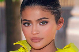 Kylie Jenner in a yellow jumpsuit