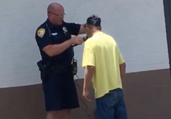Homeless man shaved by police officer