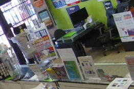 armed robber locked in phone shop